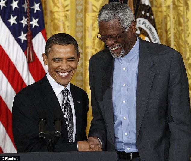Tall order: President Obama shakes hands with basketball legend Bill Russell