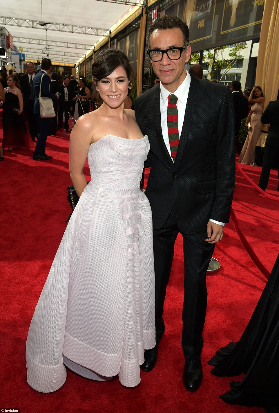 Man of style: Fred Armisen sharpened up in a perforated black suit as he posed beside Yael