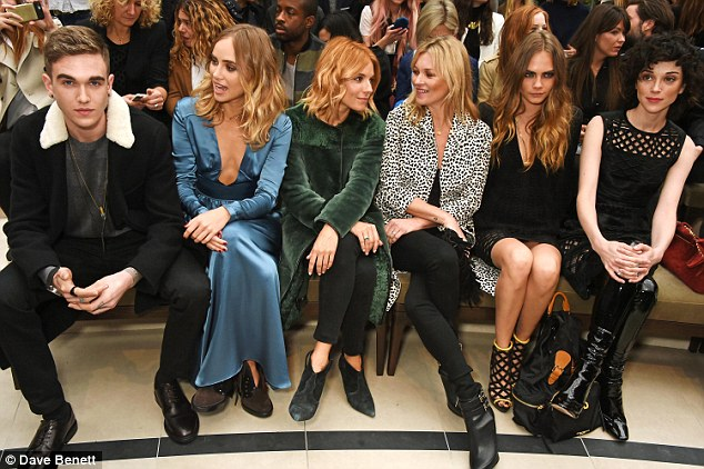 Pride of place: (L to R) Suki Waterhouse, Sienna Miller, Kate Moss, Cara Delevingne and St Vincent enjoyed a chat before the models took to the catwalk