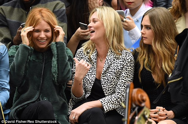 Sienna Miller, Kate Moss and Cara Delevingne watched the  Burberry Prorsum show from the frow