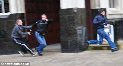 Hot pursuit: Police are appealing for the brave man who tried to stop the robbers to come forward