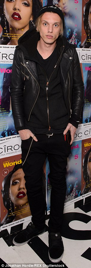 Best-dressed men: Jamie Campbell-Bower cut a casual figure in a black, zip-up hoodie, black jeans, leather jacket and hat