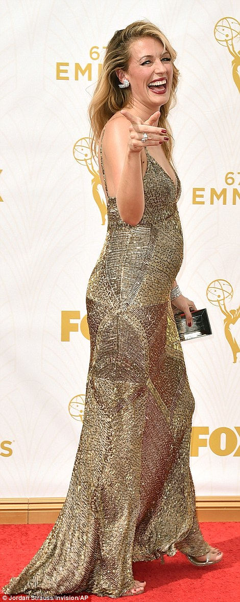 Bubbly: The 38-year-old British beauty was in a playful mood on the red carpet