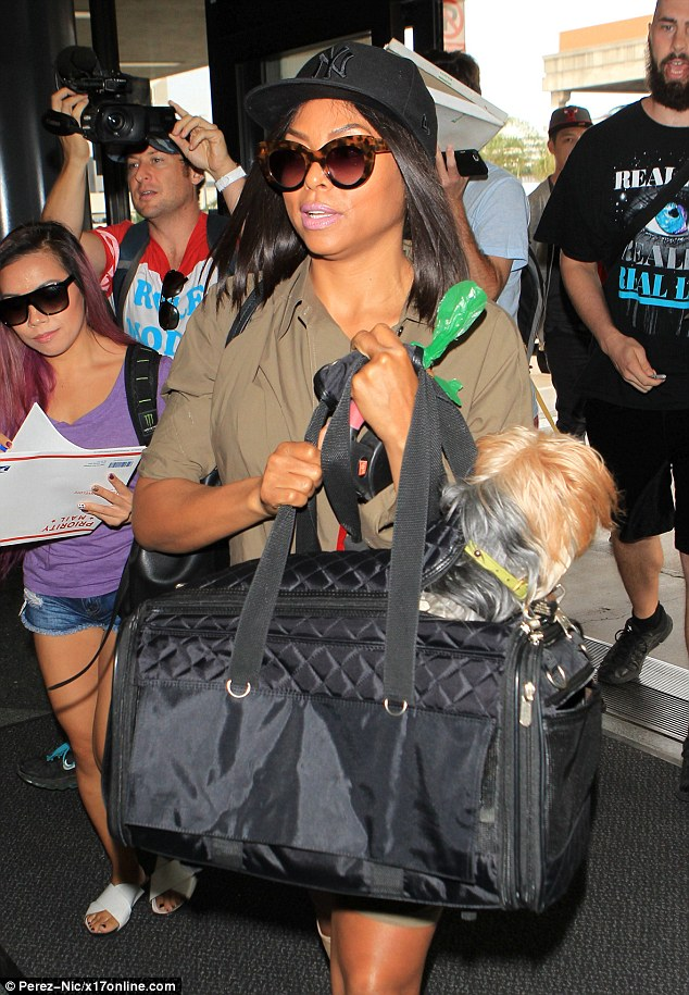 Raising the woof: She caused quite a stir as she sauntered past the adoring autograph hunters