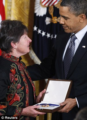 Poignant: President Obama presents Libby Little, the widow of Dr Tom Little, who was killed in Afghanistan while working for the National Organization of Ophthalmic Rehabilitation Eye with the posthumous award