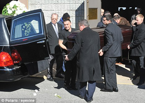 Final journey: Mourners including her boyfriend Gerard Honig, first from right, help carry Yelena Bulchenko's coffin at a joint funeral for her and her mother, Anna