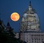 This dramatic full moon next to the scaffold-shrouded U.S. Capitol was taken on July 31, 2015 in Washington. This was a ?blue moon??--the second of two full moons in a single calendar month. Credits: NASA/Bill Ingalls