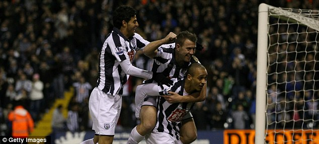 Noses in front: Peter Odemwingie is mobbed after scoring for West Brom