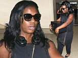 Picture Shows: Uzo Aduba  September 22, 2015\n \n 'Orange Is The New Black' actress Uzo Aduba is seen departing on a flight at LAX airport in Los Angeles, California. Uzo was carrying her Emmy Award in a black box as she made her way through the airport. \n \n Non Exclusive\n UK RIGHTS ONLY\n \n Pictures by : FameFlynet UK ? 2015\n Tel : +44 (0)20 3551 5049\n Email : info@fameflynet.uk.com