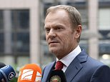 European Council President Donald Tusk talks to the press as he arrives to attend an European Union (EU) emergency summit on the migration crisis with a focus on strengthening external borders, at the EU Headquarters in Brussels, on September 23, 2015, a day after interior ministers agreed a deal on refugee relocation quotas.  AFP PHOTO / THIERRY CHARLIERTHIERRY CHARLIER/AFP/Getty Images