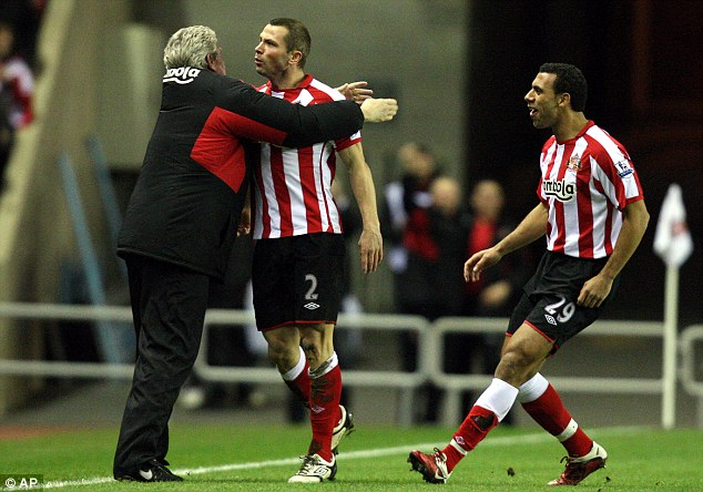 Manager's approval: Bardsley (centre) celebrates his opening goal for Sunderland with his boss Steve Bruce