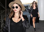 Please contact X17 before any use of these exclusive photos - x17@x17agency.com   Miranda Kerr flying solo with boots, tight dress and hat heading out of LAX  September 22, 2015 X17online.com