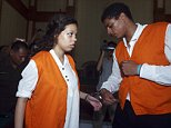 FILE - In this March 31, 2015 file photo, Heather Mack, 19, left, and her boyfriend Tommy Schaefer, 21, of Chicago, are handcuffed as they arrive at a courtroom during their trial in Bali, Indonesia. Mack and Schaefer, 19, were both convicted in the killing of Mackís mother, Sheila von Wiese-Mack, whose body was found stuffed inside a suitcase in a taxi at a Bali resort. Federal prosecutors in Chicago have filed conspiracy charges against the cousin of a person involved in the slaying of von Wiese-Mack. Prosecutors say 24-year-old Robert Bibbs of Chicago advised Tommy Schaefer and Schaefer's girlfriend, Heather Mack, on how to kill Mack's mother. (AP Photo/Firdia Lisnawati, File)