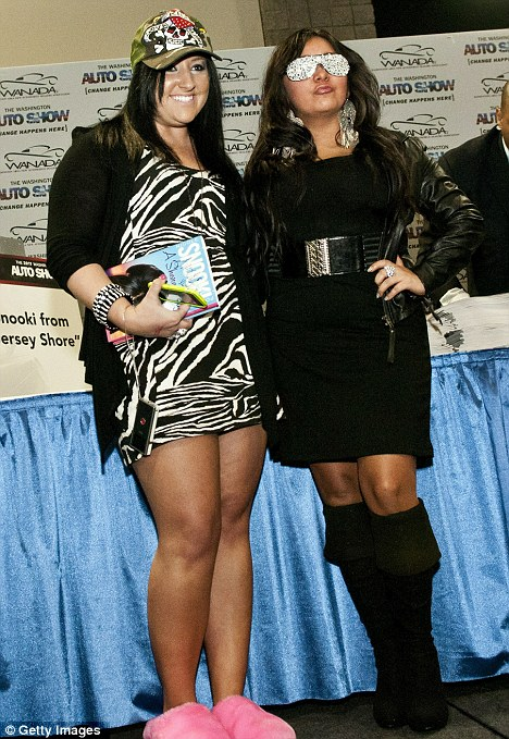 Double vision: Jersey Shore star Nicole 'Snooki' Polizzi poses with a lookalike fan at a contest in Washington DC where she was on the search for a doppelganger