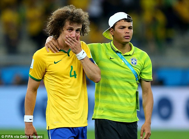Devastation: A tearful David Luiz is comforted by Thiago Silva after the Germany result that shook Brazil