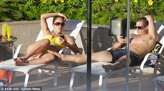 Mixing business with pleasure: The hopeless romantic and three-time divorcee's current boyfriend Casper Smart, seen here in Brazil, serves as her tour's principle choreographer