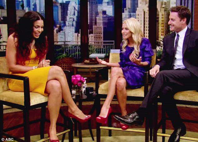 Elegant: Jordin looked pretty in canary yellow during an appearance on ABC's Live with Kelly, with guest co-host Chris Harrison