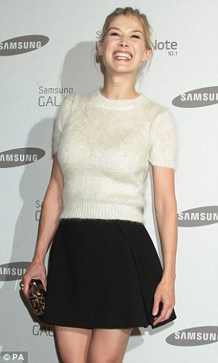 Here come the girls: Rosamund Pike kept it fun and flirty in a monochrome skirt and top combo, while Eliza Doolittle opted for a patterned zip-through dress