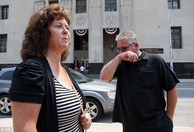 Ex-patient: Terry Spurlock (right), from Holly, Michigan,  speaks with his wife Nikii outside federal court on Monday. Mr Spurlock was among the 553 patients who were fleeced out of their money by Fata