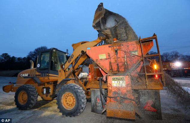 At the ready: The first city trucks are loaded with rock & salt to begin rolling out to prepare roads in Atlanta