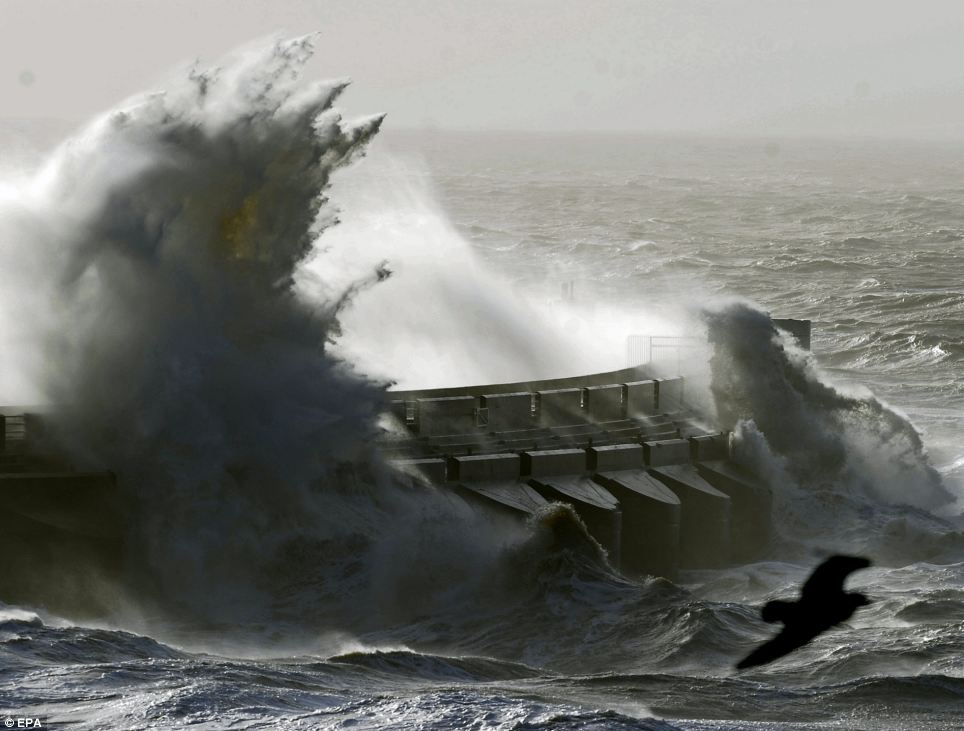 Rough seas pound Brighton Marina, on England's south coast, as more than 140,000 homes are without power following the violent storms