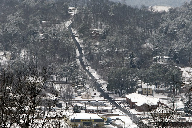 Crippling to the region: In Fort Payne, Alabama a winter storm dropped from 1 inch to 3 inches of wintry precipitation across a wide area, turning trees and roads white and forcing hundreds of schools, businesses and government offices to close