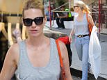 UK CLIENTS MUST CREDIT: AKM-GSI ONLY EXCLUSIVE: West Hollywood, CA - Blonde beauty January Jones looks happy after getting some retail shopping done at Zimmermann Melrose Place.  Pictured: January Jones Ref: SPL1135207  230915   EXCLUSIVE Picture by: AKM-GSI / Splash News