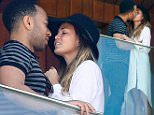 UK CLIENTS MUST CREDIT: AKM-GSI ONLY\nEXCLUSIVE: Rio de Janeiro, Brazil - John Legend and Chrissy Teigen display their Love while enjoying the view from their hotel balcony in Rio, Legend is currently in Town to perform during Rock in Rio music festival. Chrissy Teigen  took a few pictures and wore a maxi white cardigan over her blouse and Daisy Dukes showing off her long legs.\n\nPictured: John Legend and Chrissy Teigen\nRef: SPL1134354  220915   EXCLUSIVE\nPicture by: AKM-GSI / Splash News\n\n