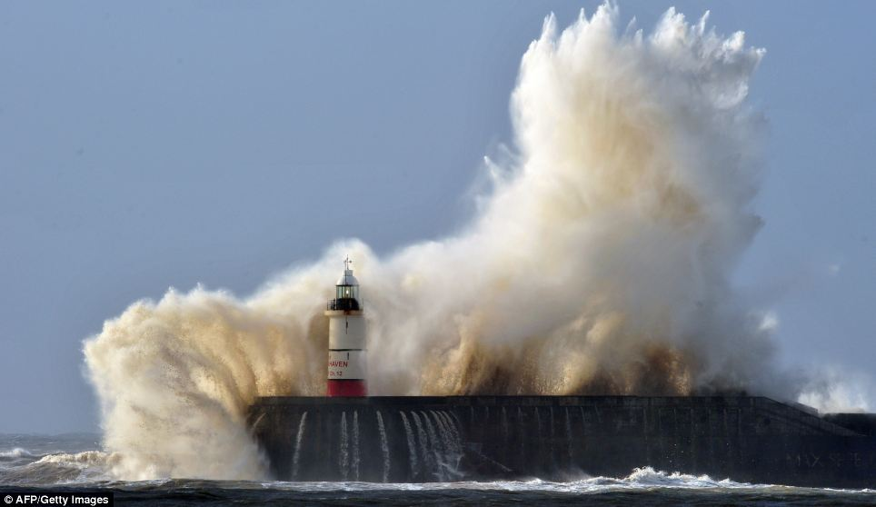 Newhaven lighthouse is battered by waves as high winds from the latest winter storm continues