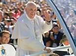 Pope Francis makes his way into the Basilica of the National Shrine of the Immaculate Conception in Washington, D.C., Wednesday,  Sept. 23, 2015, as people cheer him on. He held a canonized mass for Father Junipero Serra on his first U.S. visit. (Mindy Schauer/The Orange County Register via AP)