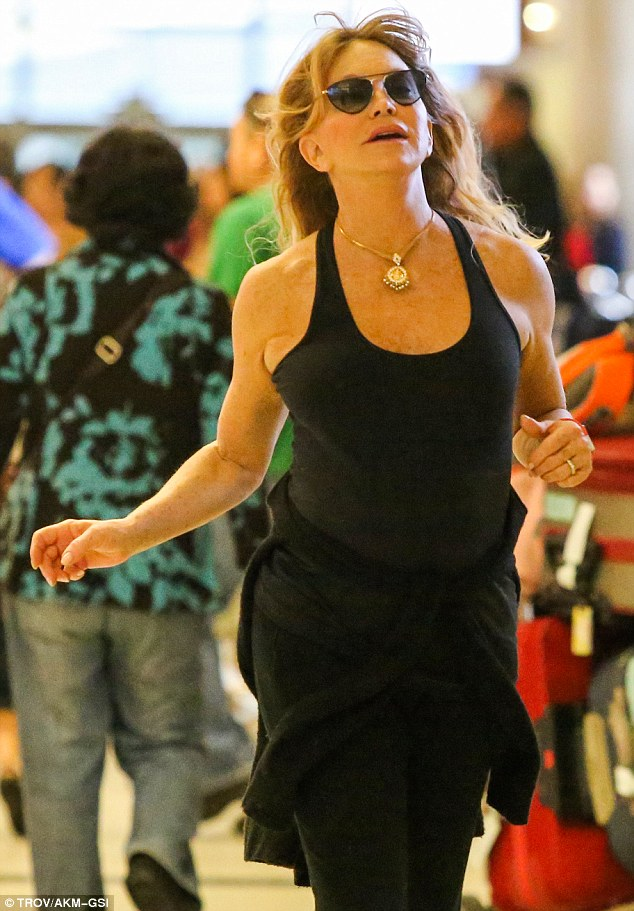 Going for Gold-ie! Goldie Hawn dashes through LAX like an Olympic sprinter after flying in from chilly London