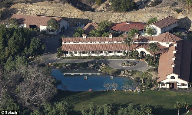 Hidden: The huge ranch is situated near Los Angeles but hidden behind huge trees away from prying eyes