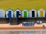 C5P49W beach huts broadsands,Broadsands beach,Beachhuts and green fields, BOATS, BLUE, SEA, SKY, SEASIDE, SCENE, SEASHORE, BATHERS, COA