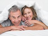 DW0FPY Cheerful middle aged couple under the duvet. Image shot 10/2013. Exact date unknown.