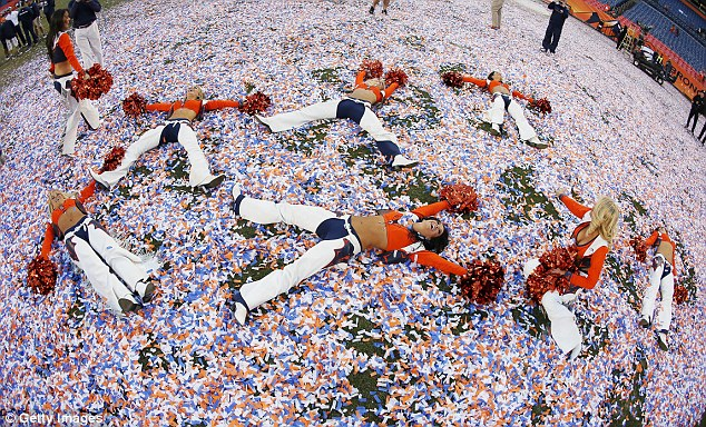 Celebrations: Denver Broncos cheerleaders make snow angels in confetti after the team beat the New England Patriots