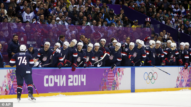 USA forward T.J. Oshie is greeted by teammates after scoring a goal against Russia. The performance lifted Oshie to hero status on social media. 'T.J. Oshie put his country on his back! Unreal,' one Twitter post said