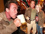 MUNICH, GERMANY - SEPTEMBER 24: Arnold Schwarzenegger and his partner Heather Milligan visit the Schuetzenfestzelt during the Oktoberfest 2015 at Theresienwiese on September 24, 2015 in Munich, Germany.  (Photo by Gisela Schober/Getty Images)