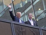 Republican presidential candidate, businessman Donald Trump, left, waves alongside his son Eric Trump  Fifth Avenue as they wait to see Pope Francis' motorcade as it travels to St. Patrick's Cathedral, Thursday, Sept. 24, 2015, in New York. (AP Photo/John Minchillo)