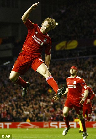 Reaching for the sky: Liverpool's Dirk Kuyt is targeting the top four
