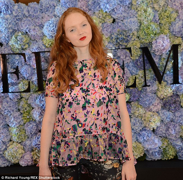 Doll-like beauty: Lily scrimped on the make-up, allowing her pretty facial features to speak for themselves as she posed in front of Erdem branding