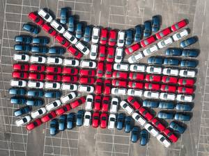 22 September 2015: Vauxhall Motors celebrates over 36 years of its iconic Brit-built Astra, with a patriotic Union Jack created by 128 of its new 7th generation models. Workers at the Ellesmere Port Plant, home of the Astra, built the flag. The all-new Astra, which has officially launched, marks the production of over 5 million cars at Ellesmere Port since 1962