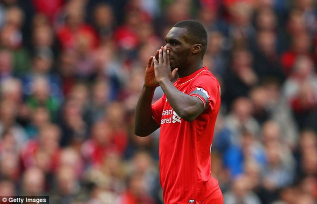 Liverpool striker Christian Benteke (pictured against Norwich City) will undergo a scan on his hamstring