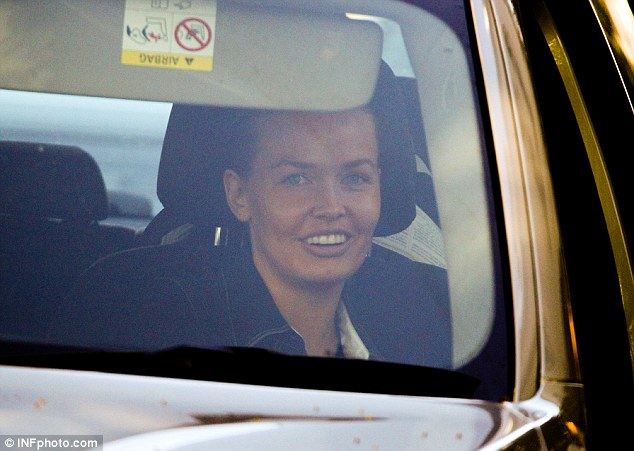 Amused: At some points Sam's wife Lara appeared to find humour in the situation, laughing as she sat in the passenger seat