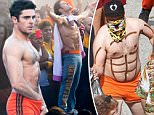 Exclusive... 51858173 Actor Zac Efron shows off his best 'Magic Mike' moves while on the set of 'Neighbors 2' in Atlanta, Georgia on September 22, 2015. Zac jumped up on a table and stripped down and danced before revealing just a small pair of orange shorts. Zac then reached down the front of his shorts to help cover up his goods. Zac didn't let the smoke from BBQ grills disrupt his dance moves. FameFlynet, Inc - Beverly Hills, CA, USA - +1 (818) 307-4813