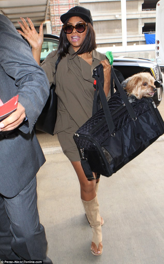 Putting her to shame:Taraji P. Henson was full of beans when she arrived at the airport