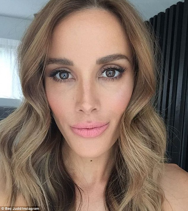 'Overdrawn of course': Rebecca Judd appeared to emulate Kylie Jenner on Monday as she overdrew her lips with a pink Kardashian Beauty lipstick to give the impression of a plumper pout
