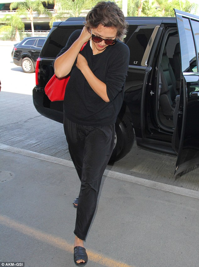 They think it's haal over: Maggie Gyllenhaal looked exhausted as she jetted out of Los Angeles on Monday following the Emmys