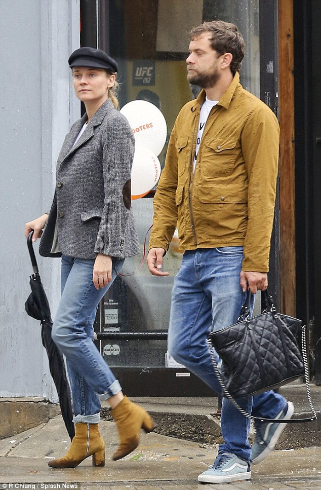What a gent: The 37-year-old actor showed was courteous to his partner of nearly a decade as he held onto her black leather quilted Chanel bag