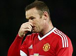 Wayne Rooney of Manchester United looks dejected during the Capital One Cup match between Manchester United and Ipswich Town played at Old Trafford stadium, Manchester