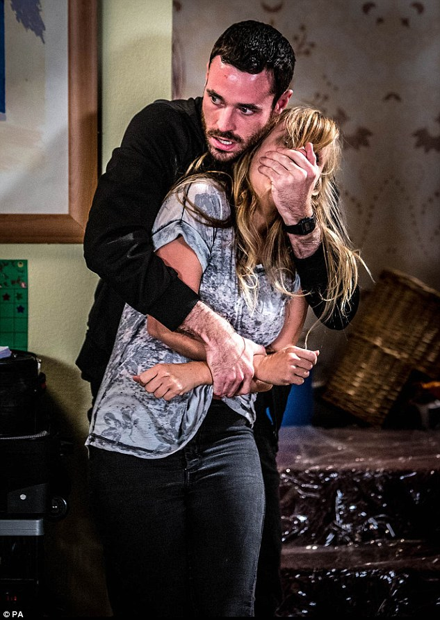 Tense: Sarah-Louise Platt is left fearing for her life after a dramatic showdown with drug dealer Callum Logan asCoronation Street stars rehearse live episode fight scene
